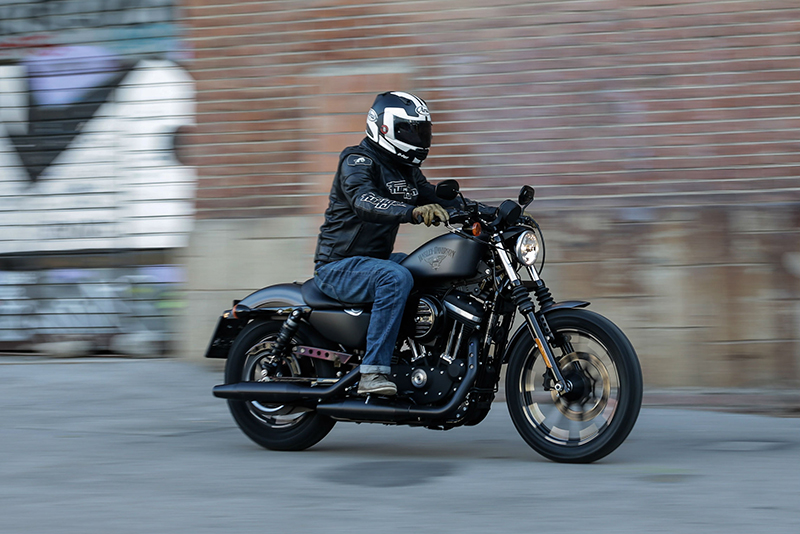 Person riding a Harley-Davidson Sportster 883 Iron